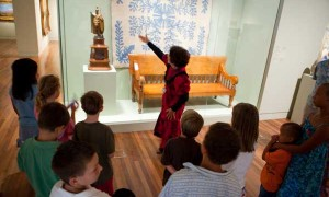 Academy docent Karlyn Pearl led children from military families on a tour of the Holt Gallery.