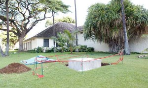 The new foundation on the front lawn, awaiting installation of the sculpture.