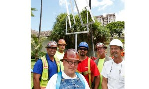 Tom Podner, in overalls, Mike Jones, in white hardhat, and the Hawaiian Crane&Rigging crew.