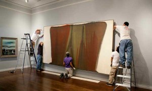 The installation crew installing the gallery of Modernist art.