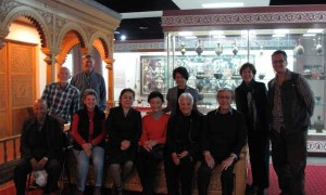 The group meeting a curator at the Xinjiang Provincial Museum.