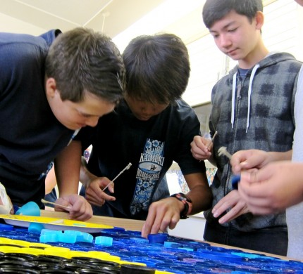 Students work on completing a sustainability mural
