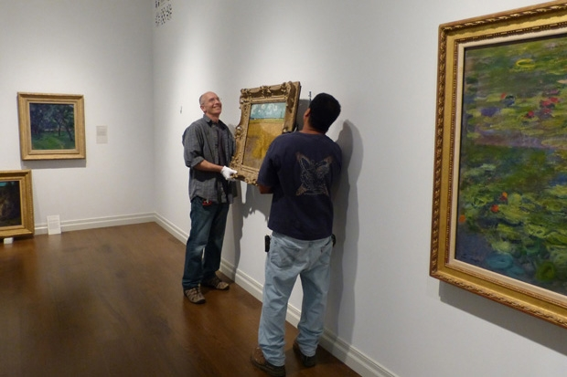 Almost done: Head preparator Marc Thomas and installation staffer Spenson Donre hang the van Gogh.