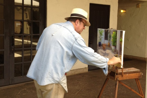 Mark Norseth paints while he's not on teaching duty in the museum's Palm Courtyard.
