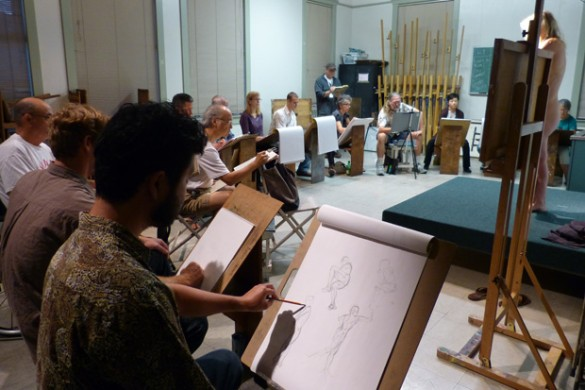 Students in Mark Norseth's Life Drawing Studio class sketch a live model.