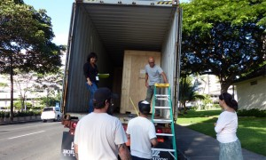 The crated 2,000-pound horses arrive in a moving van.