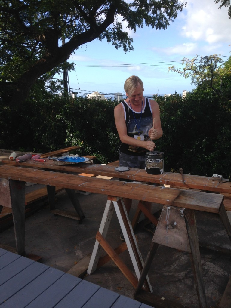 Dan Falardeau works on the frame of the garden bed