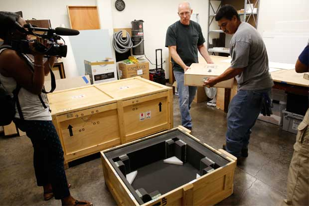 Marc Thomas and Spender Donre pack up the second crate headed for New York City.