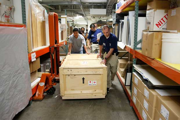 HSI special agents and museum staff wheel the crates to HSI's awaiting truck.