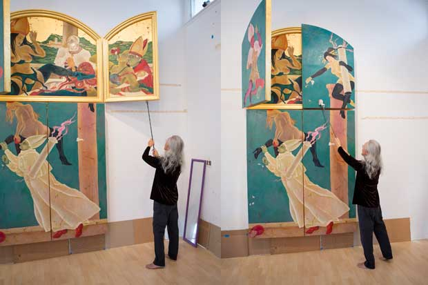 Masami Teraoka demonstrates how the panels on his triptychs open and close.