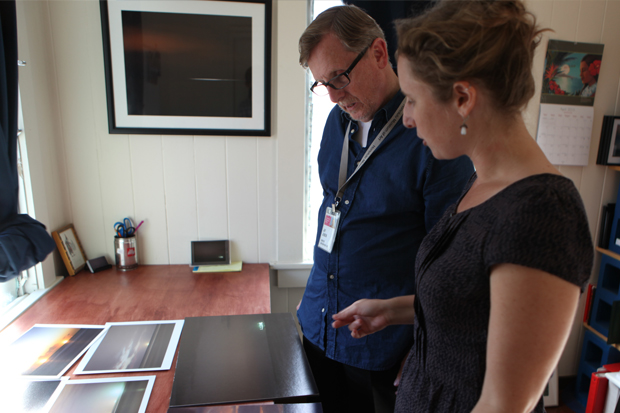Artist Alison Beste and Jensen look at examples of how 'Oil Tanker Sunsets' might be printed for the exhibition