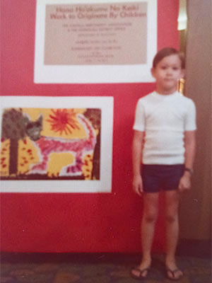 As a child, the museum's new director Sean O'Harrow took art classes at the museum.  Here he is proudly posing beside one of his works in one of the museum's corridors.