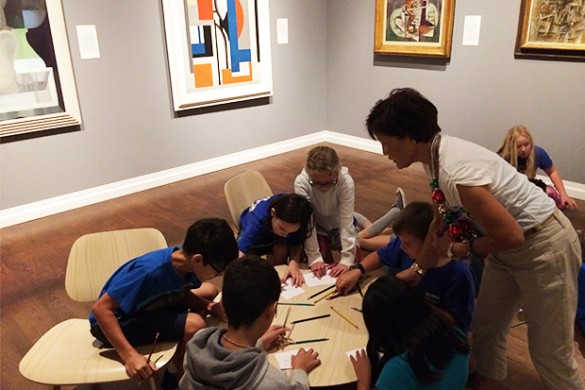 Students experiment with color and how it affects mood during the European and American Masterpieces tour with docent Debby Cowland.