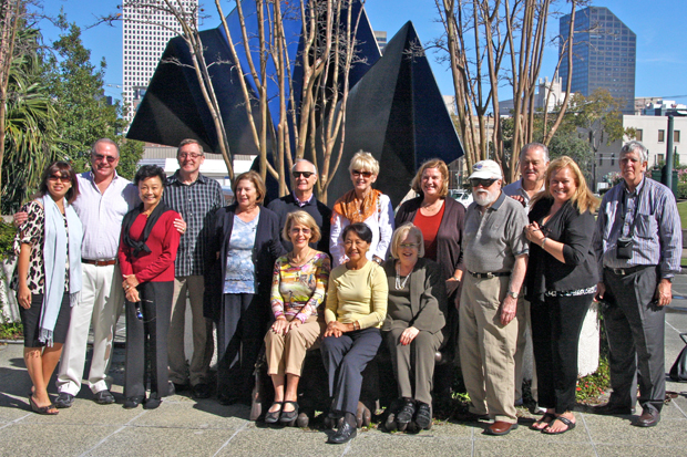 Jay Jensen leads a group, which includes museum trustees, on an art tour of New Orleans