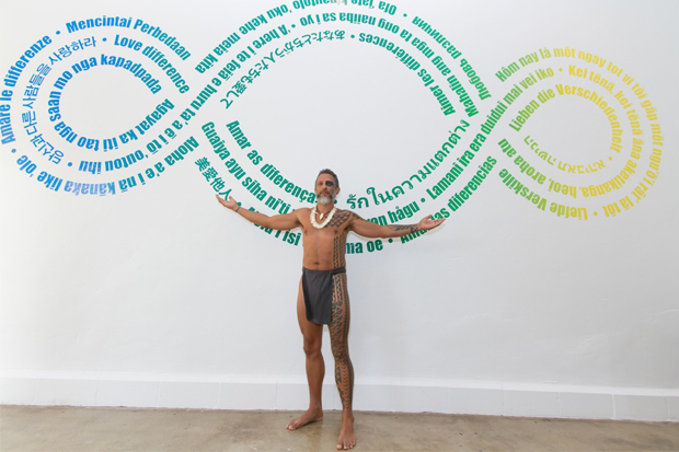 "Standing in front of Pistoletto's ""Terzo Paradiso,"" which is available for purchase as a temporary tattoo, Keliiokalani Makua (who was featured in our exhibition ""Tattoo Honolulu,"" blessed the the gallery on its opening night in March."