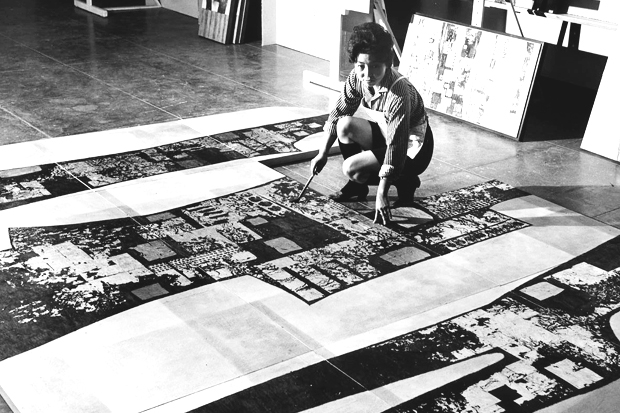 "Tseng Yuho at the museum in 1964, working on what at the time was one of the ""largest works ever completed in Hawaiʻi,"" a nine-panel dsui mural titled ""Feeling of Redwoods."""