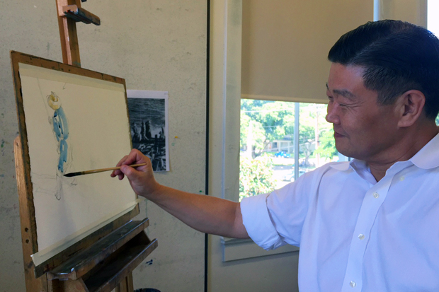 Lee demonstrates watercolor technique.