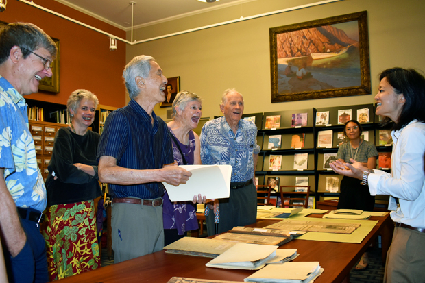 Archivist Dawn Sueoka, right, swaps stories of Catharine E.B. Cox and Kaua'i with the Cox family.