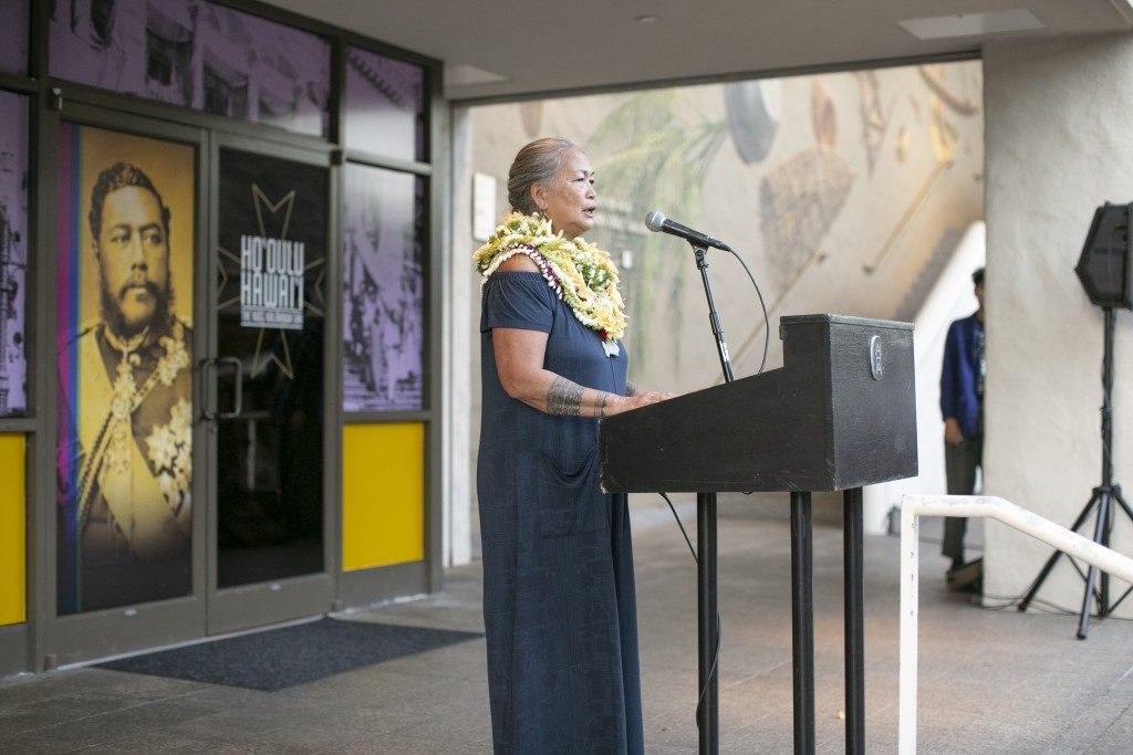Maile Andrade giving thanks before the exhibition opened