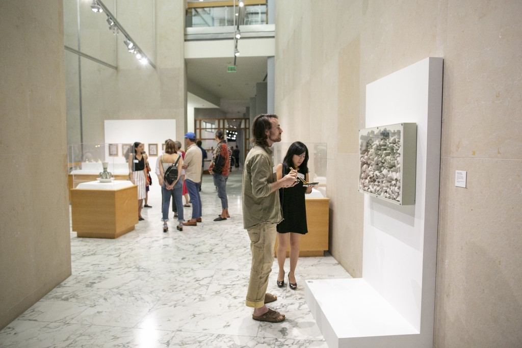 "Guests in front of Spangler and Czibesz's ""Tectonic and Dross."""