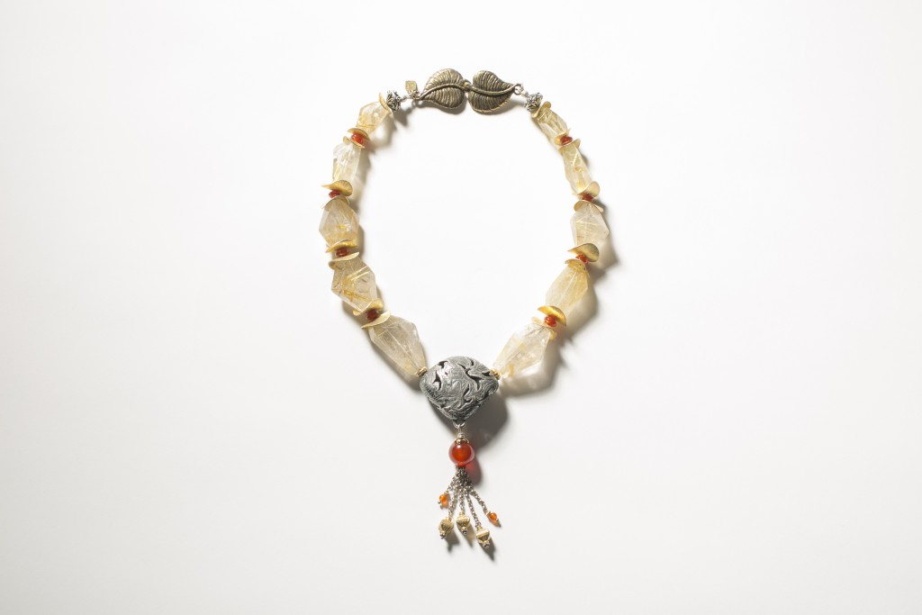 Local jewelry maker Candice Wakumoto combines silver and gold in this eclectic piece.