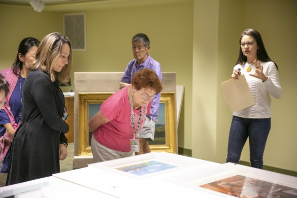 Curatorial assistant Jesi Lujan Bennett (right) discussing works from Micronesia