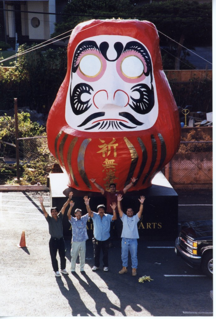 Fujio Kaneko and his team with the 17-foot-tall daruma they built for the the Luce Pavilion Complex groundbreaking ceremony in September 1999. Front, L-R: Liberato Cabe, Fujio Kaneko, Abundio Cabe, Paul Caleb. Back: Spenson Donre.