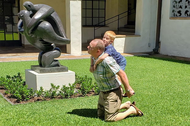 Life imitates art: Dan and Ray McNab have fun with Jacques Lipschitz's 'Mother and Child.'