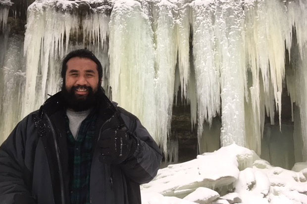 Wilbert Alik visiting the Eben Ice Caves in Michigan, where he is studying anthropology.
